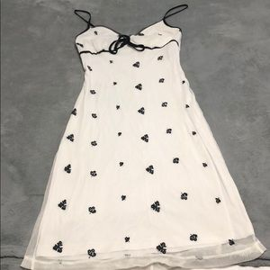 Below knee dress white dress sigh black flowers